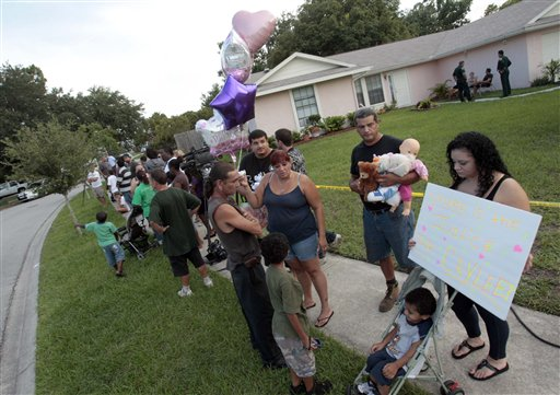 "<div class=""meta image-caption""><div class=""origin-logo origin-image none""><span>none</span></div><span class=""caption-text"">A group of neighbors and visitors stand across the street from the George and Cindy Anthony residence as most express their disagreement with the Casey Anthony verdict. (AP)</span></div>"