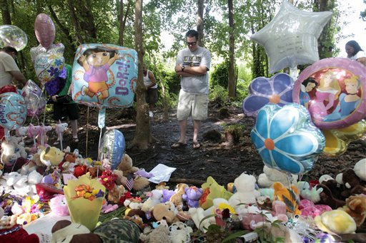 "<div class=""meta image-caption""><div class=""origin-logo origin-image none""><span>none</span></div><span class=""caption-text"">Corey Stroud prays at a Caylee Anthony memorial in Orlando, Fla., Wednesday, July 6, 2011. (ASSOCIATED PRESS)</span></div>"