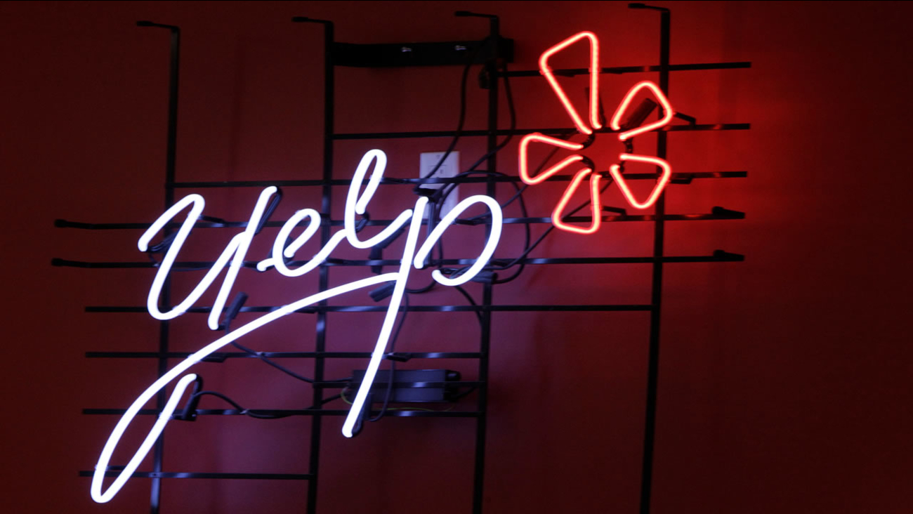 This is an undated file image of a neon sign advertising Yelp.
