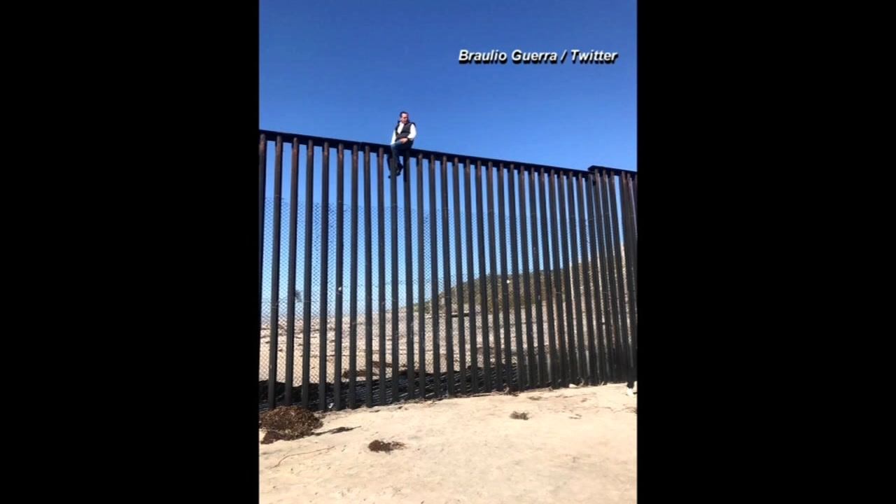 Congressman Braulio Guerra tweeted this picture of himself sitting on top of a border fence near Tijuana, Mexico.