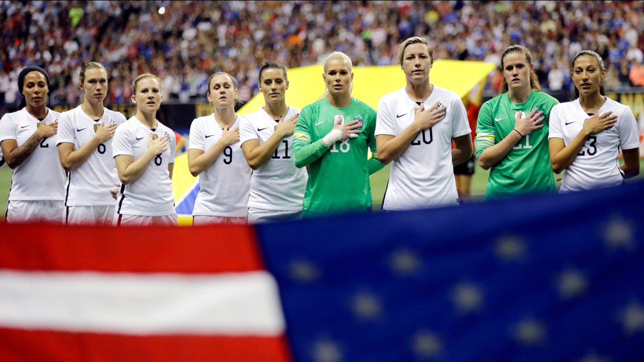 In this Dec. 10, 2015, file photo, the United States' women's national team lines up for the national anthem before an international soccer match against Trinidad & Tobago.