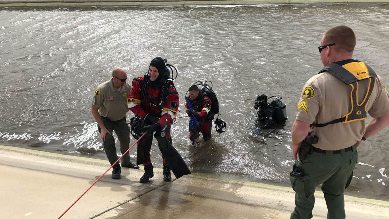 Members of the San Bernardino County sheriff's Dive Team are seen in an aqueduct in Hesperia during the search for a missing 2-year-old boy.