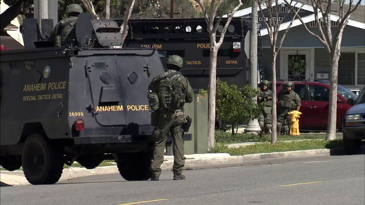 SWAT members with the Anaheim Police Department surround a home near Water and Clementine streets on Monday, March 6, 2017.