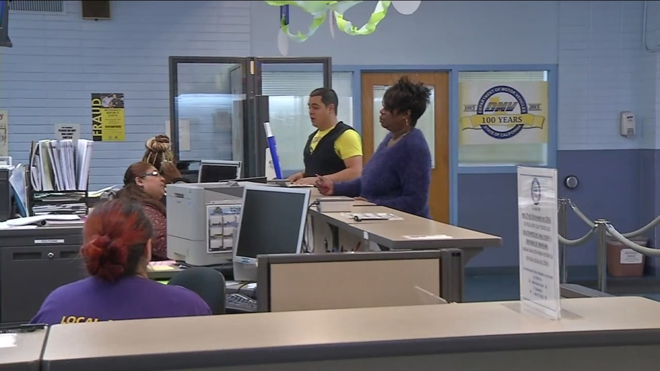 Customers wait at the counter at the DMV in this undated photo.