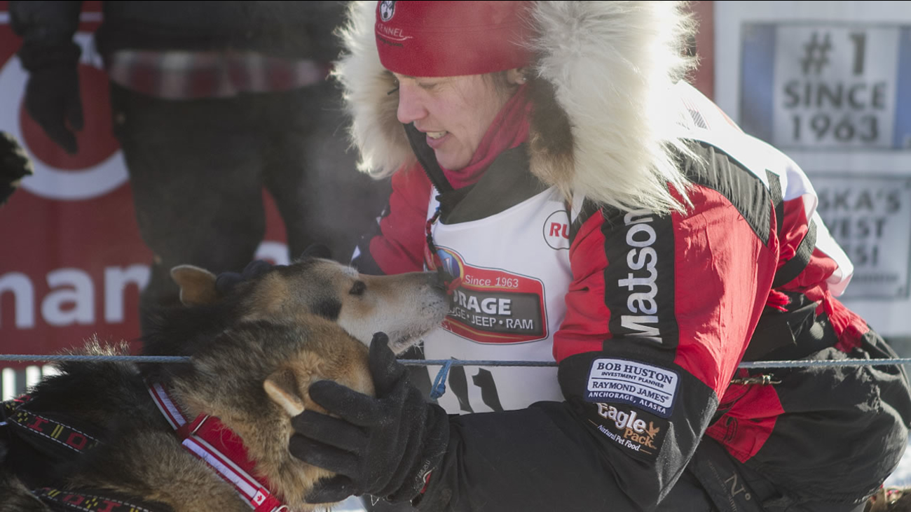 Aliy Zirkle takes a moment with her dogs at the start of the 45th Iditarod Trail Sled Dog Race in Fairbanks, Alaska, Monday, March 6,2017. (AP Photo/Ellamarie Quimby)