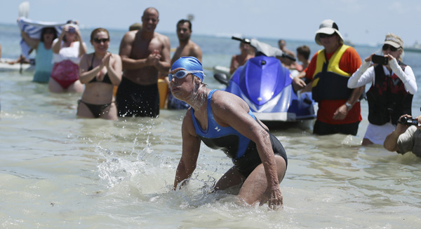 "<div class=""meta image-caption""><div class=""origin-logo origin-image none""><span>none</span></div><span class=""caption-text"">U.S. endurance swimmer Diana Nyad walks ashore becoming the first person to swim from Cuba to Florida without the help of a shark cage. (AP Photo/J Pat Carter)</span></div>"