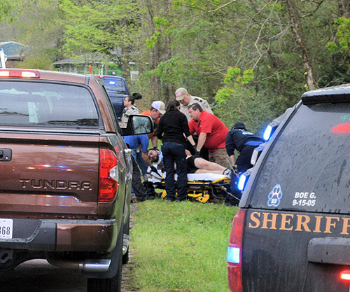 <div class='meta'><div class='origin-logo' data-origin='none'></div><span class='caption-text' data-credit='PolkCountyToday.com'>The suspect was transported from the scene by ambulance.</span></div>