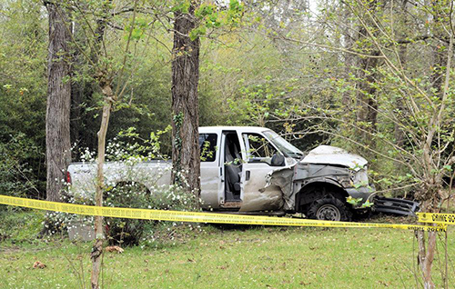 <div class='meta'><div class='origin-logo' data-origin='none'></div><span class='caption-text' data-credit='PolkCountyToday.com'>The suspect vehicle was lodged between 3 large trees.</span></div>