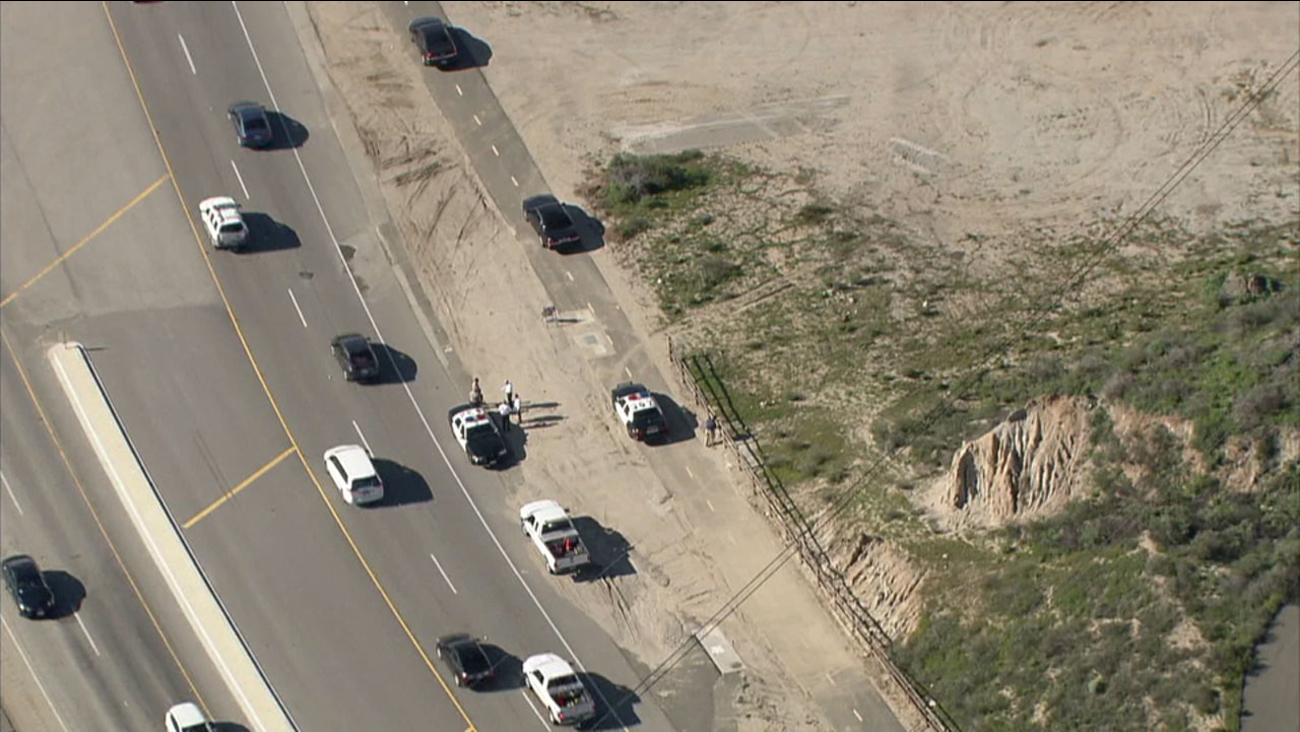 Sheriff's officials investigate possible human remains on the side of a road in Santa Clarita on Tuesday, March 7, 2017.
