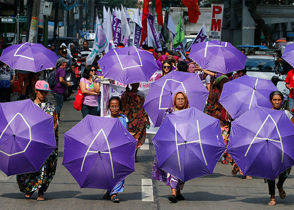 "<div class=""meta image-caption""><div class=""origin-logo origin-image kabc""><span>kabc</span></div><span class=""caption-text"">Filipino women march towards a downtown park in for a rally to mark International Women's Day (Bullit Marquez/AP)</span></div>"