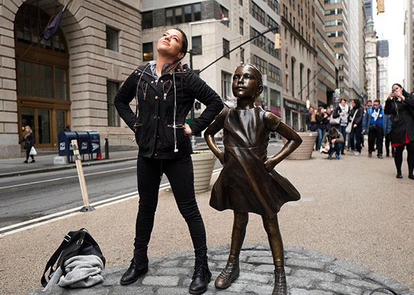"<div class=""meta image-caption""><div class=""origin-logo origin-image kabc""><span>kabc</span></div><span class=""caption-text"">A woman strikes a pose in front of a statue titled ""Fearless Girl"" in New York. (Mark Lennihan/AP)</span></div>"