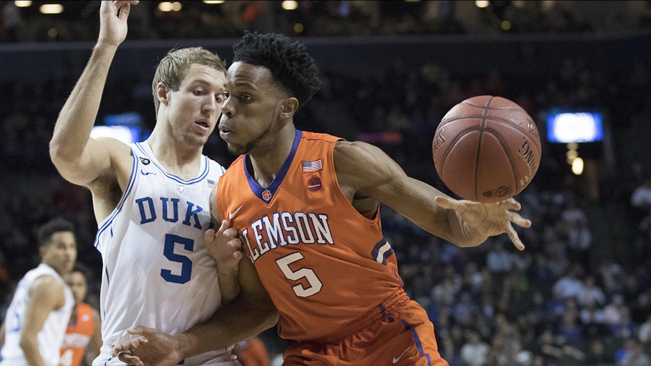 Duke's Luke Kennard, left, guards Clemson forward Jaron Blossomgame on Wednesday at the ACC Tournament.