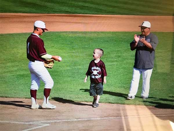 Jesse Esphorst Jr., his younger brother Cody and their father are seen at the Babe Ruth World Series in 2016.
