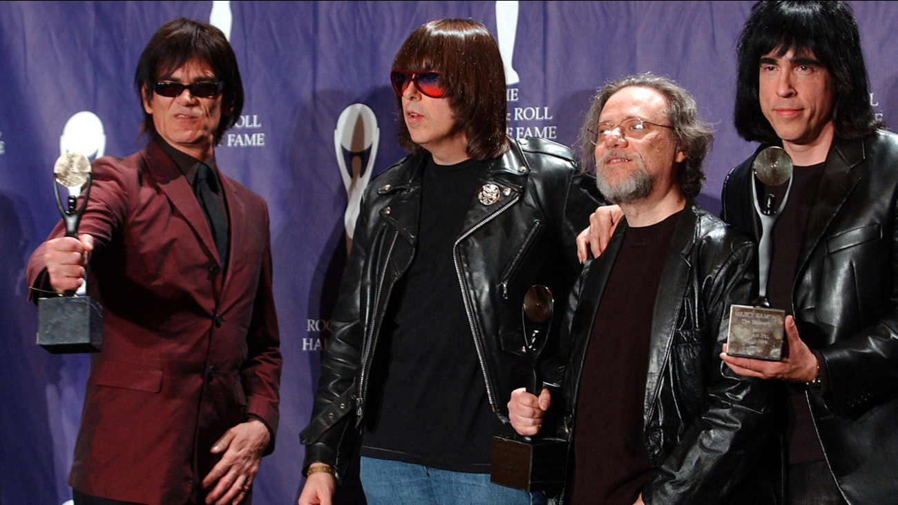 Members of the Ramones, from left to right, Dee Dee, Johnny, Tommy and Marky Ramone hold their awards after being inducted at the Rock and Roll Hall of Fame on March 18, 2002.