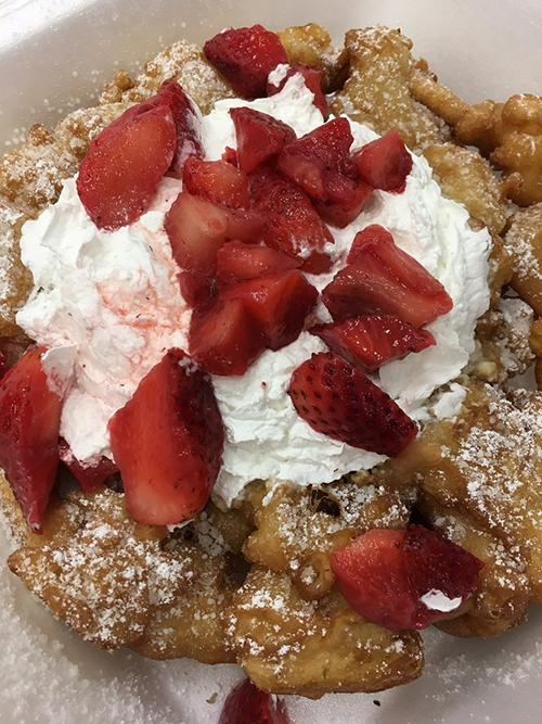 """<div class=""""meta image-caption""""><div class=""""origin-logo origin-image ktrk""""><span>KTRK</span></div><span class=""""caption-text"""">Katherine Whaley judges funnel cake at the Gold Buckle Foodie Awards.</span></div>"""