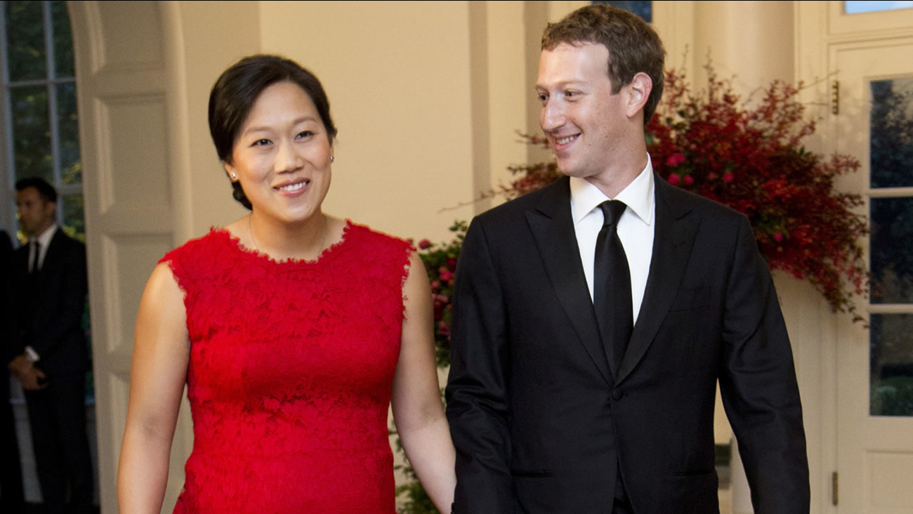 In this Friday, Sept. 25, 2015, file photo, Facebook Chairman and CEO Mark Zuckerberg and his wife, Priscilla Chan, arrive for a State Dinner in honor of Chinese President Xi Jinping, in the East Room of the White House in Washington.
