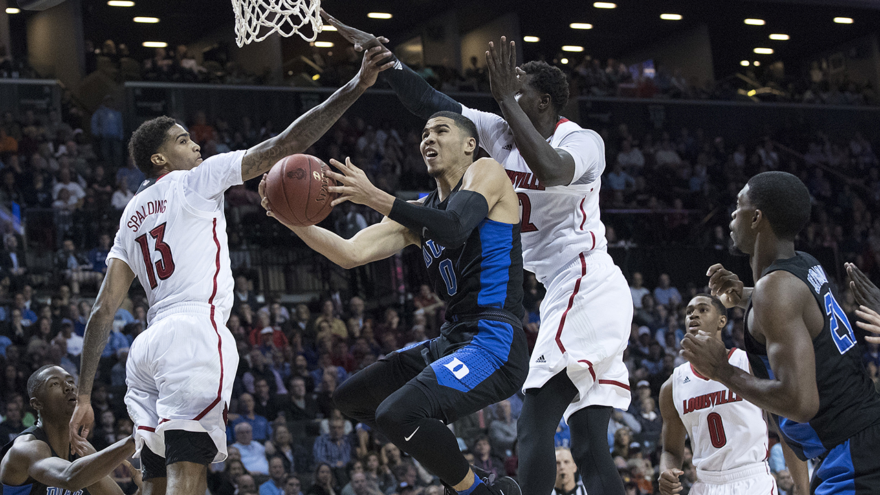 Duke forward Jayson Tatum slices between Louisville forward Ray Spalding (13) and forward Mangok Mathiang on Thursday.