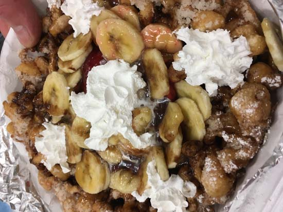 """<div class=""""meta image-caption""""><div class=""""origin-logo origin-image ktrk""""><span>KTRK</span></div><span class=""""caption-text"""">Patricia Lopez tests funnel cake with banana, strawberries and chocolate.</span></div>"""