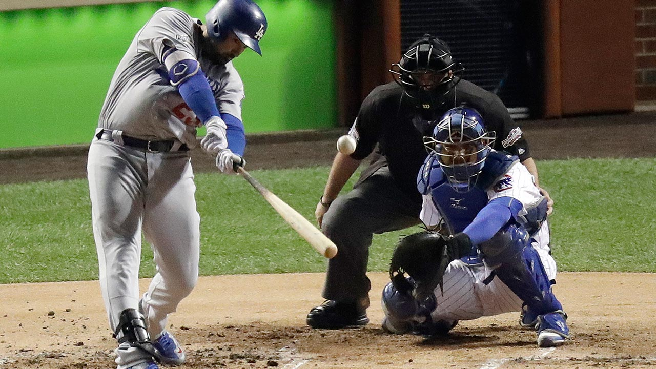 Los Angeles Dodgers first baseman Adrian Gonzalez hits a home run during the second inning of Game 2 of the National League baseball championship series on Sunday, Oct. 1, 2016.