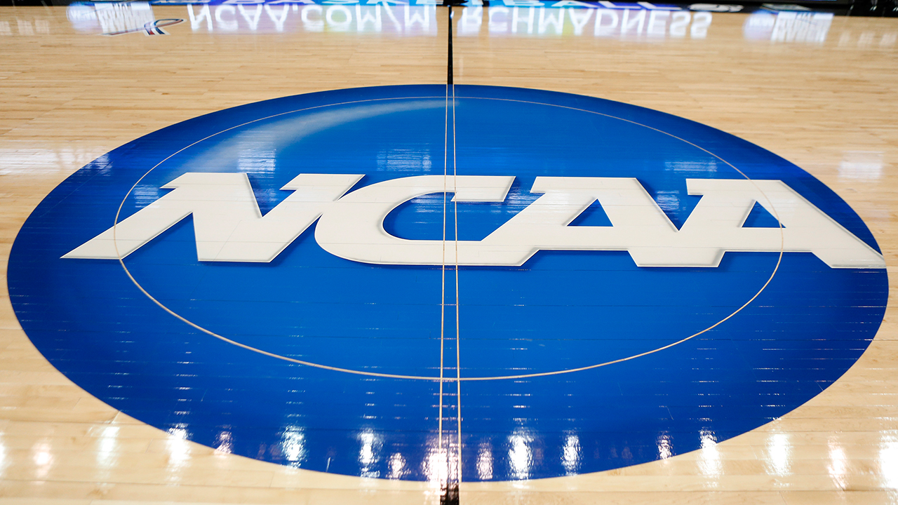 In this March 18, 2015, file photo, the NCAA logo is at center court in Pittsburgh.
