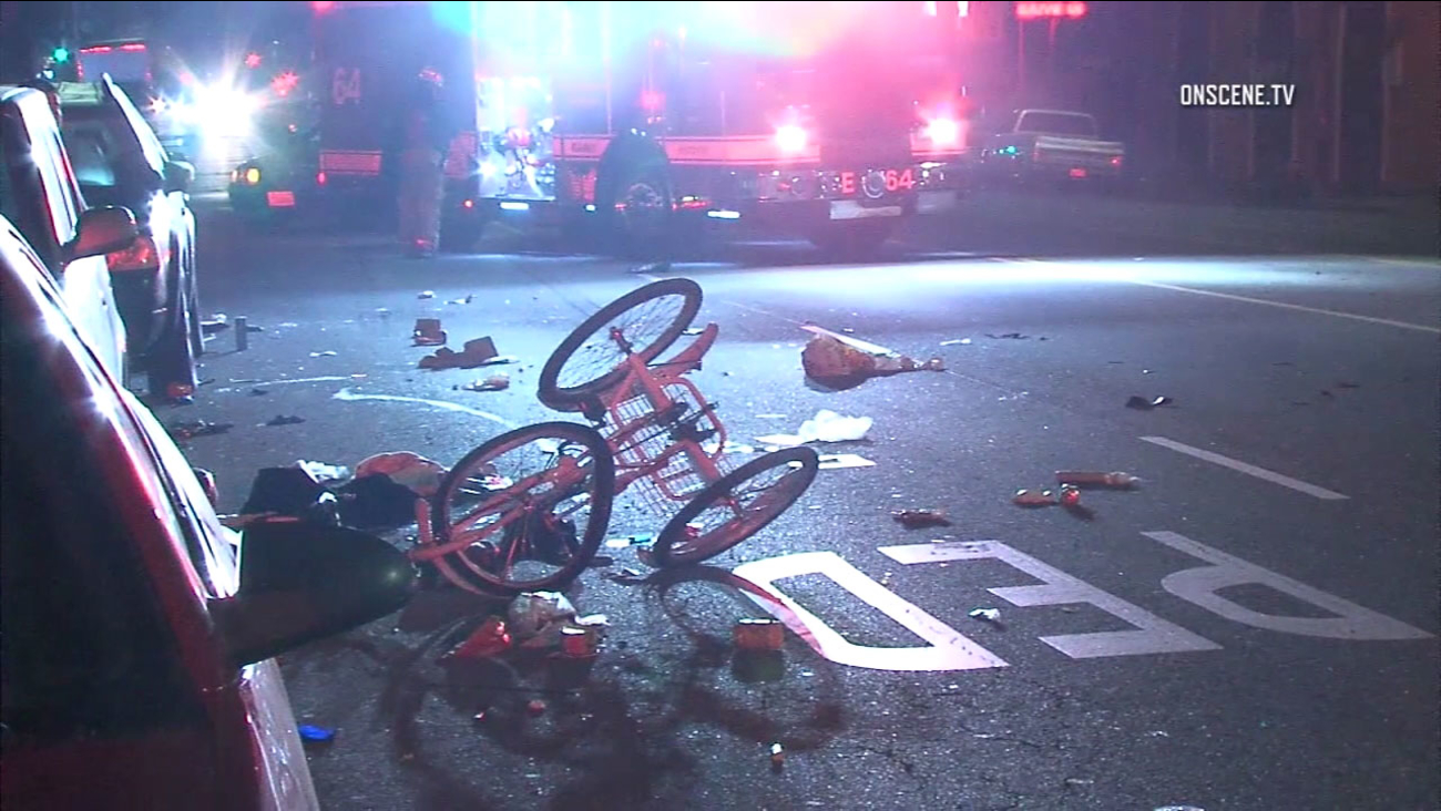 A tricycle is turned over following a hit-and-run in South Los Angeles that left a woman in critcal condition on Monday, March 13, 2017.