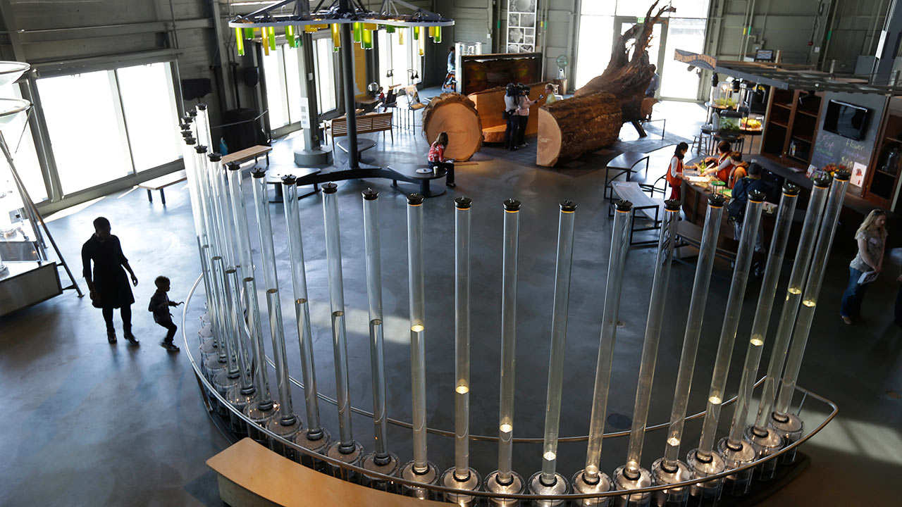 A child looks over an exhibit at the Exploratorium in San Francisco, Tuesday, April 9, 2013.