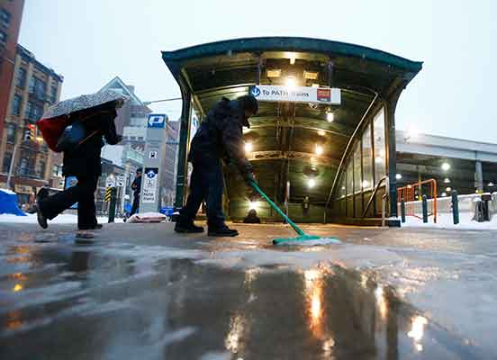 "<div class=""meta image-caption""><div class=""origin-logo origin-image wabc""><span>wabc</span></div><span class=""caption-text"">A worker uses a squeegee to push snow and rain mixture away from the entrance of the Hoboken PATH train station during a snowstorm, Tuesday, March 14, 2017, in Hoboken, N.J. (AP Photo/Julio Cortez)</span></div>"