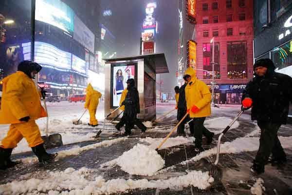 "<div class=""meta image-caption""><div class=""origin-logo origin-image wabc""><span>wabc</span></div><span class=""caption-text"">A crew of snow shovelers work as a snowstorm sweeps through Times Square, Tuesday, March 14, 2017, in New York. (AP Photo/Mark Lennihan)</span></div>"