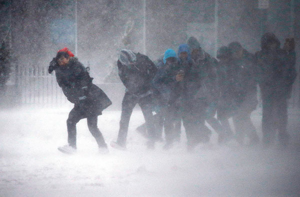 """<div class=""""meta image-caption""""><div class=""""origin-logo origin-image none""""><span>none</span></div><span class=""""caption-text"""">People struggle to walk in the blowing snow during a winter storm Tuesday, March 14, 2017, in Boston. (Michael Dwyer/AP Photo)</span></div>"""