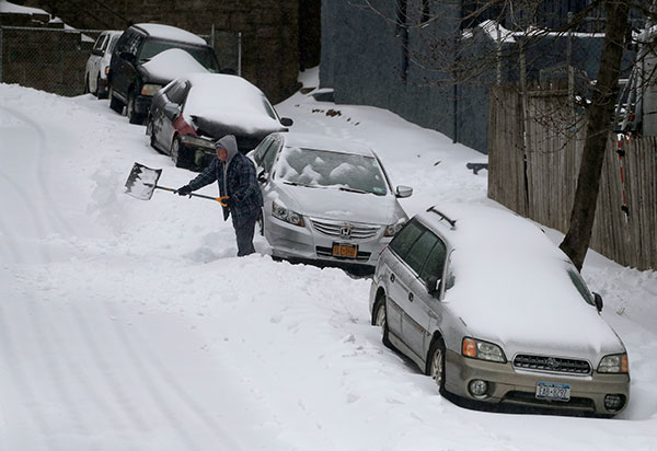 """<div class=""""meta image-caption""""><div class=""""origin-logo origin-image none""""><span>none</span></div><span class=""""caption-text"""">A man digs his car out along William Street during a snow storm, Tuesday, March 14, 2017, in New York. (Julie Jacobson/AP Photo)</span></div>"""
