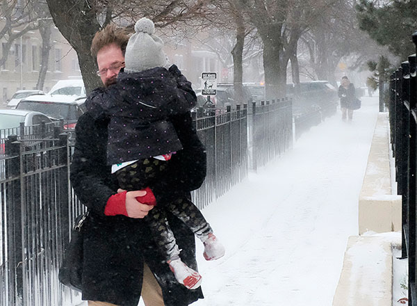 """<div class=""""meta image-caption""""><div class=""""origin-logo origin-image none""""><span>none</span></div><span class=""""caption-text"""">A commuter fights wind gusts as he carries his daughter to school, Tuesday, March 14, 2017, in Chicago. (Kiichiro Sato/AP Photo)</span></div>"""