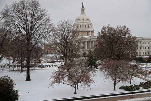 "<div class=""meta image-caption""><div class=""origin-logo origin-image none""><span>none</span></div><span class=""caption-text"">Snow covers Capitol Hill in Washington, early Tuesday, March, 14, 2017. (J. Scott Applewhite/AP Photo)</span></div>"