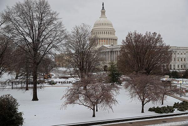 "<div class=""meta image-caption""><div class=""origin-logo origin-image none""><span>none</span></div><span class=""caption-text"">Snow covers Capitol Hill in Washington, early Tuesday, March, 14, 2017. (J. Scott Applewhite/AP Photo)</span></div>"