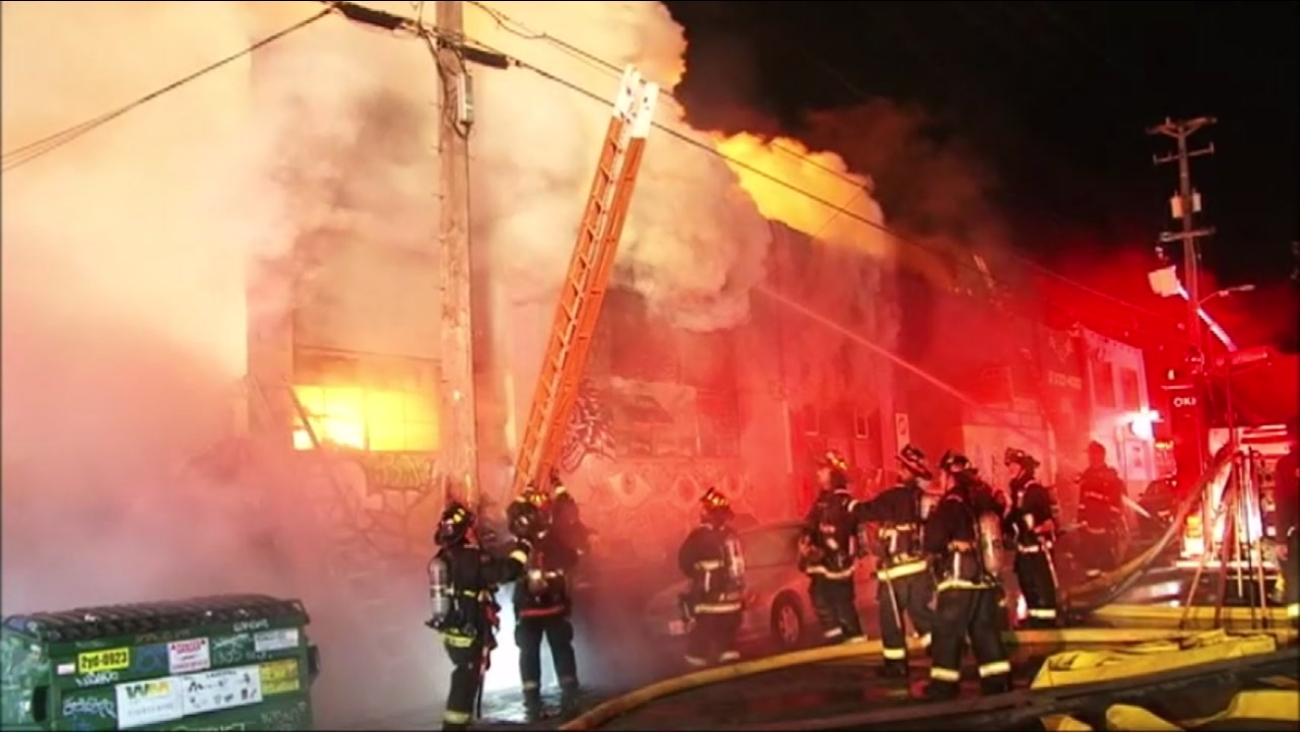 Crews are seen battling a fire at the Ghost Ship warehouse in Oakland, Calif. on February 15, 2017.