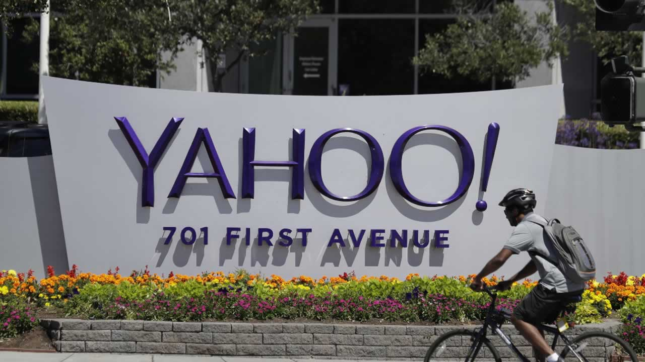 In this Tuesday, July 19, 2016 file photo, a cyclist rides past a Yahoo sign at the company's headquarters in Sunnyvale, Calif.