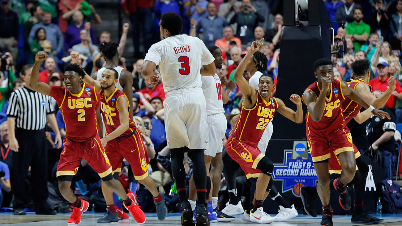 USC players celebrate their 66-65 win in the first round of the NCAA tournament in Tulsa, Okla. on Friday, March 17, 2017.