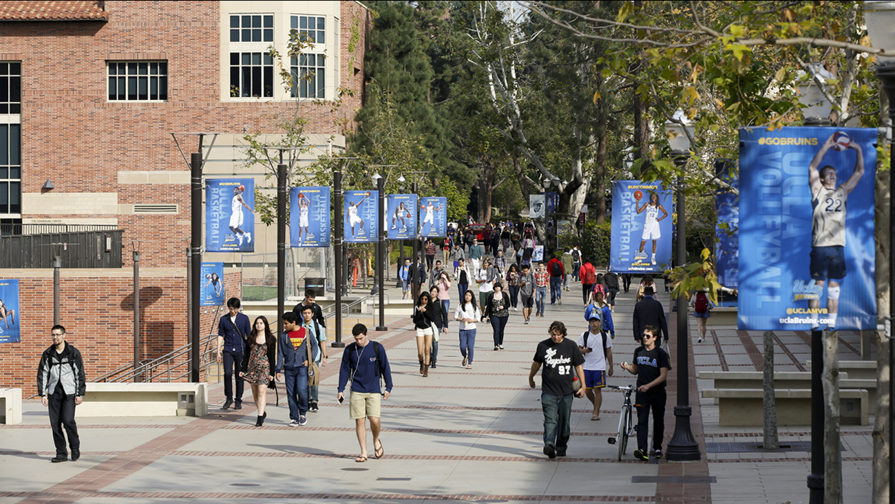 FILE - In this Feb. 26, 2015, file photo, students walk on the UCLA campus in Los Angeles.