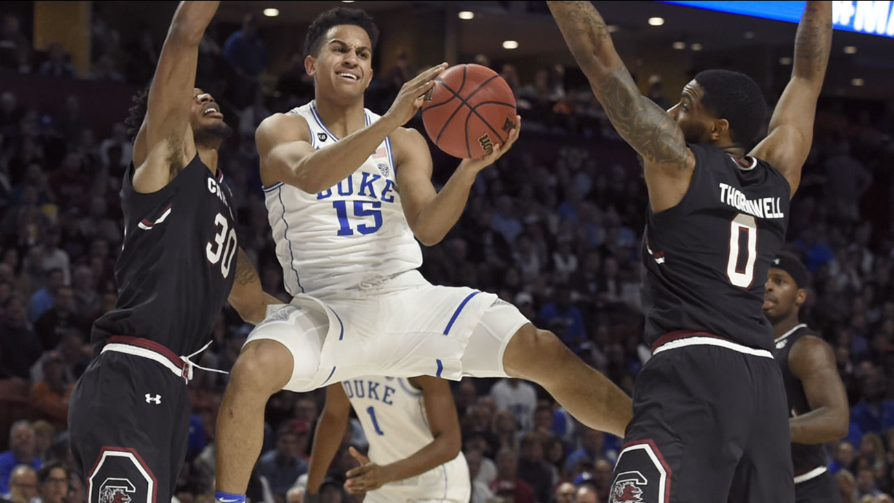 Duke's Frank Jackson (15) looks to pass as South Carolina's Sindarius Thornwell (0) and Chris Silva (30) defend  (AP Photo/Rainier Ehrhardt)