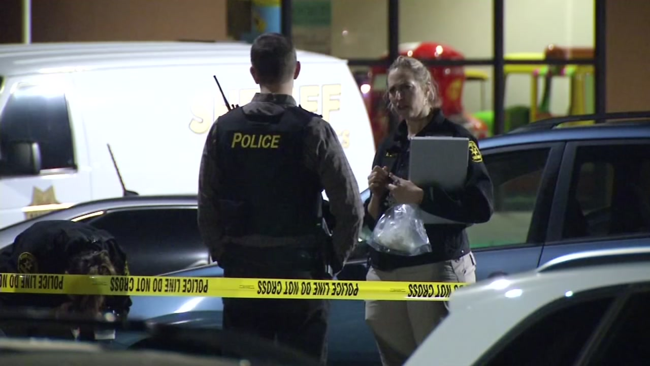Police investigate a shooting at a mall parking lot in Capitola, Calif. on Sunday, March 19, 2017.