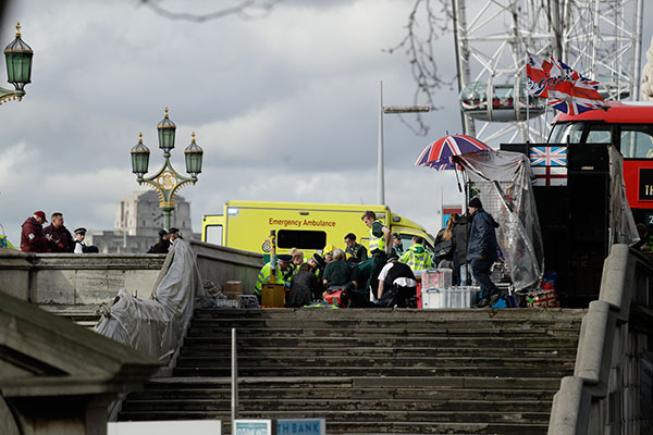 "<div class=""meta image-caption""><div class=""origin-logo origin-image none""><span>none</span></div><span class=""caption-text"">Emergency services staff provide medical attention close to the Houses of Parliament in London, Wednesday, March 22, 2017. (Matt Dunham/AP Photo)</span></div>"
