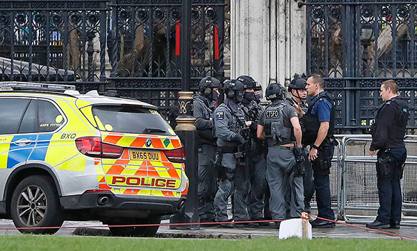 <div class='meta'><div class='origin-logo' data-origin='none'></div><span class='caption-text' data-credit='Kirsty Wigglesworth/AP Photo'>Armed police officers gather outside of the Houses of Parliament in London, Wednesday, March 23, 2017.</span></div>
