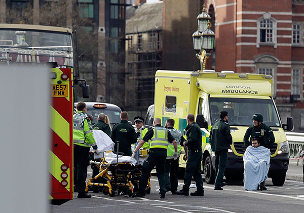 <div class='meta'><div class='origin-logo' data-origin='none'></div><span class='caption-text' data-credit='Matt Dunham/AP Photo'>Emergency services staff provide medical attention close to the Houses of Parliament in London, Wednesday, March 22, 2017</span></div>