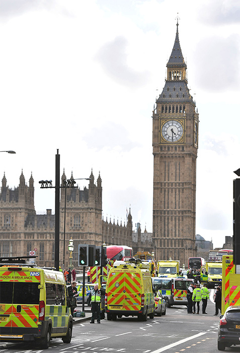"<div class=""meta image-caption""><div class=""origin-logo origin-image none""><span>none</span></div><span class=""caption-text"">Emergency services on Westminister Bridge after a policeman was stabbed and his apparent attacker shot by officers. (Dominic Lipinski/PA via AP)</span></div>"