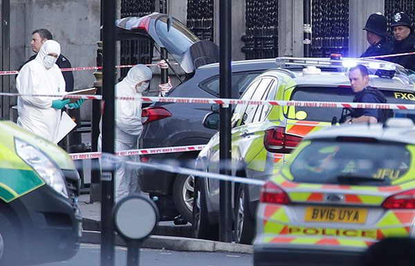 <div class='meta'><div class='origin-logo' data-origin='none'></div><span class='caption-text' data-credit='Yui Mok/PA via AP'>Police forensic officers at the scene close to the Houses of Parliament in London, Wednesday, March 22, 2017.</span></div>