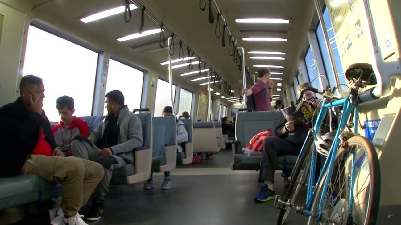 BART passengers ride a train on March, 22, 2017.
