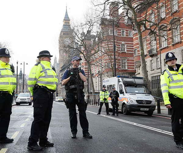 "<div class=""meta image-caption""><div class=""origin-logo origin-image wabc""><span>wabc</span></div><span class=""caption-text"">Police officers stand guard on a road leading to the Houses of Parliament in London, Thursday March 23, 2017. (Kirsty Wigglesworth/AP Photo)</span></div>"