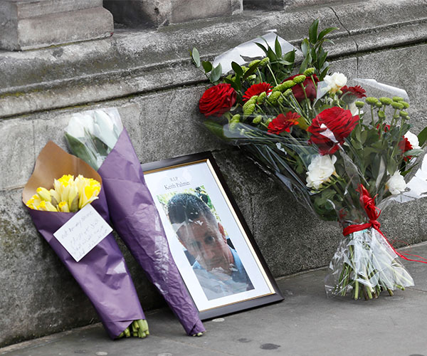 "<div class=""meta image-caption""><div class=""origin-logo origin-image wabc""><span>wabc</span></div><span class=""caption-text"">Flowers and a photo of killed police officer Keith Palmer on Whitehall near the Houses of Parliament in London, Thursday March 23, 2017. (Kirsty Wigglesworth/AP)</span></div>"