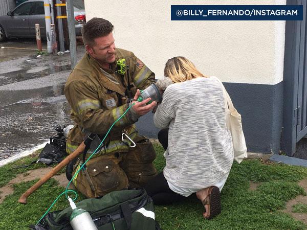Owner Crystal Lamirande hugs her dog Nalu after firefighter Andrew Klein saved her beloved pet's life.