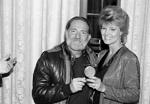 <div class='meta'><div class='origin-logo' data-origin='AP'></div><span class='caption-text' data-credit='AP Photo'>Willie Nelson poses with his wife, Connie, after receiving the Lifetime Achievement Award at the Songwriter's Hall of Fame Awards ceremony on March 7, 1983.</span></div>