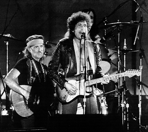 <div class='meta'><div class='origin-logo' data-origin='AP'></div><span class='caption-text' data-credit='AP'>Country Singer Willie Nelson joined folk and rock singer Bob Dylan, right, on stage before more than 78,000 people attending the Farm Aid benefit concert.</span></div>